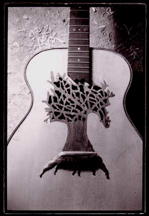 guitar with tree design